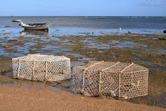 Fish traps and boats at low tide, Rodrigues Island Stock Photo