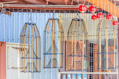 Fish traps hanging  outisde a house. Fish traps hanging outside of a house in Chew Jetty floating village in Georgetown, Penang, Malaysia Royalty Free Stock Images