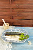 Fish tray with parsley and garlic stock images