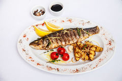 Fish, trout grill with vegetables and potatoes Stock Image