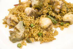 Fish and vegetable paella. Typical from valencia Stock Photo