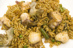 Fish and vegetable paella. Typical from valencia Stock Photos