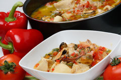 Fish and vegetable stew in bowl. On table Royalty Free Stock Photo