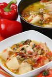 Fish and vegetable stew in bowl. On table Stock Photo
