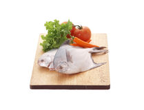 Fish and vegetable in wooden tray Stock Photography