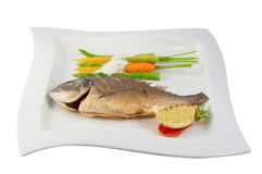 Fish with vegetables stock images