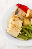 Fish with vegetables Stock Photos