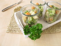 Fish and vegetables on rice in glasses Stock Image