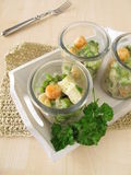 Fish and vegetables on rice in glasses Stock Photos