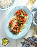 Fish Veracruz. Delicious white fish veracruz with olives, capers, tomato, jalapeno pepper and cilantro Stock Photos