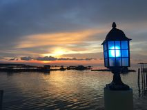 Fish village converted into resort in Kukup, Malaysia. Favorite spot for visitor or tourist to capture sunset Royalty Free Stock Photos