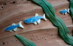 The fish on the wall.  stock images