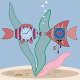 Fish and watch. Two bright striped fish with a clock inside look at each other Stock Photo