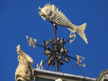 Fish Weather Vane at Old Billingsgate Fish Market in London. The beautiful architectural detail of a Weather Vane at the Old Billingsgate Fish Market building in stock image