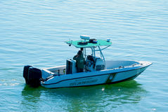 Fish and Wildlife Commission boat on patrol Stock Image