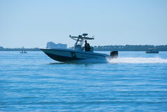 Fish and Wildlife officers on boat patrol Stock Photos