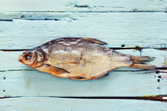 Fish on wooden background. This is a fish on the wood desk royalty free stock photo