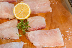 Fish on wooden cutting board ready for cooking Royalty Free Stock Image