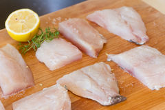 Fish on wooden cutting board ready for cooking Stock Photo