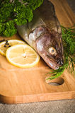 Fish  on a wooden kitchen board Royalty Free Stock Photo