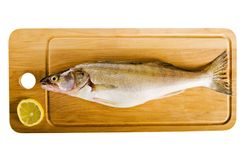Fish  on a wooden kitchen board Stock Photo