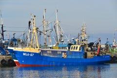 Fishboat i en hamn Royaltyfri Bild