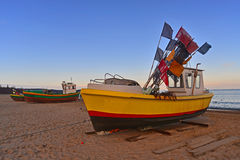 Fishboat on the shore. A small fishboat after morning fishing on the strand in Sopot, Northern Poland Royalty Free Stock Photo