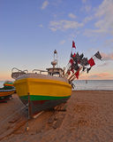 Fishboat on the shore. A small fishboat after morning fishing on the strand in Sopot, Northern Poland Stock Images