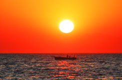 Fishboat at sunset Royalty Free Stock Images