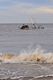 Fishboat Wreck. Wreck of a fish boat sinking in sea bottom after stormy winter weather Stock Photos