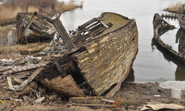 Fishboat Wreck. S of wooden cutters near a canal in Gdansk harbour, Poland Stock Photos