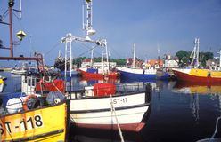 Fishboats in a harbor Stock Images