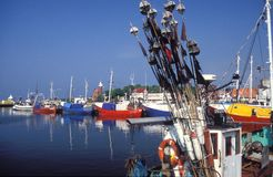 Fishboats in a harbor Stock Photos