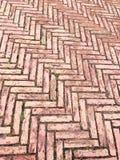 Fishbone-patterned red bricks pavement Royalty Free Stock Photo