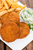 Fishburger with fresh made Chips Stock Photography