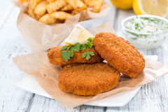 Fishburger with fresh made Chips Royalty Free Stock Images