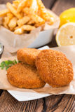 Fishburger with fresh made Chips Royalty Free Stock Photo