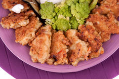 Fishcakes and aubergine. Fishcakes, aubergine with sour cream and broccoli Stock Photo