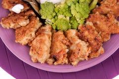 Fishcakes and aubergine Stock Photo