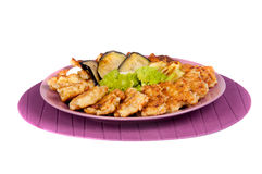Fishcakes and aubergine. Fishcakes, aubergine with sour cream and broccoli Stock Image