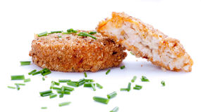 Fishcakes with chives royalty free stock image