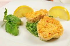 Fishcakes with lemon Stock Images