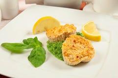 Fishcakes with lemon Stock Photos