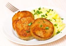 Fishcakes with mashed potatoes Stock Images