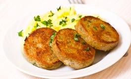 Fishcakes with mashed potatoes Stock Image