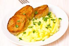 Fishcakes with mashed potatoes Stock Photography
