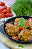 Fishcakes in tomato sauce in a iron skillet Stock Photography