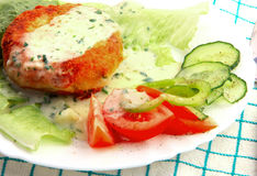 Fishcakes with vegetables. Royalty Free Stock Photography