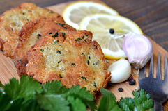 Fishcakes on wooden board Stock Image