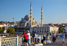 A fishemen on Galata Bridge in front of New Mosque in Istanbul Royalty Free Stock Images